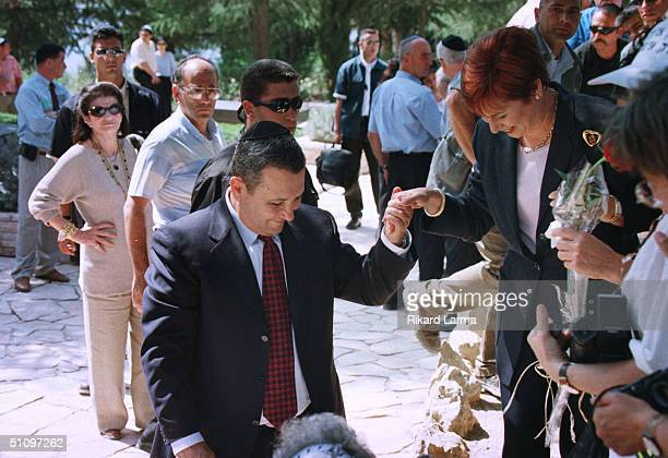 Israeli Prime Minister Elect Ehud Barak Helps His Wife Nava Embraces Leah Rabin , While Visiting The Grave Of Her Husband, Assassinated Prime...