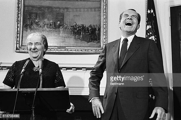 Israeli Prime Minister Golda Meir and US President Richard Nixon break into laughter just before making their final statements in the Roosevelt Room...