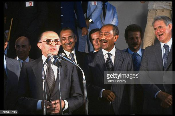 Israeli Prime Minister Menachem Begin Egyptian President Anwar Sadat and US Secretary of State Cyrus Vance speaking to war wounded at auditorium...