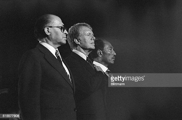 Israeli Prime Minister Menachem Begin President Carter and Egyptian President Anwar Sadat stand together during the playing of the national anthem at...
