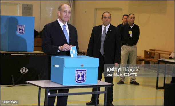 Israeli Prime Minister Minister Ehud Olmert poses for the cameras prior to casting his ballot in Jerusalem