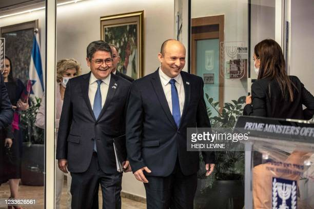 Israeli Prime Minister Naftali Bennett and Honduran President Juan Orlando Hernandez arrive to give their press statements at the Prime Minister's...