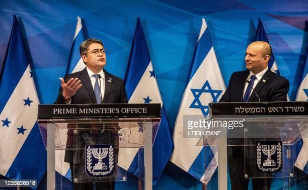 Israeli Prime Minister Naftali Bennett listens to Honduran President Juan Orlando Hernandez , during their statements at the Prime Minister's Office...
