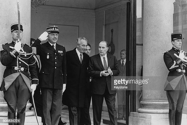 Israeli Prime Minister Shimon Peres talking to French President Francois Mitterrand as they leave the Elysee Palace, Paris, April 21st 1986.