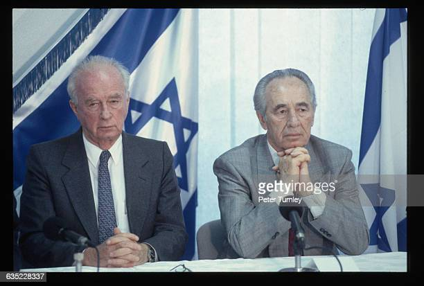 Israeli Prime Minister Yitzhak Rabin, left, and Foreign Minister Shimon Peres, together with PLO leader Yasser Arafat, won the Nobel Peace Prize for...