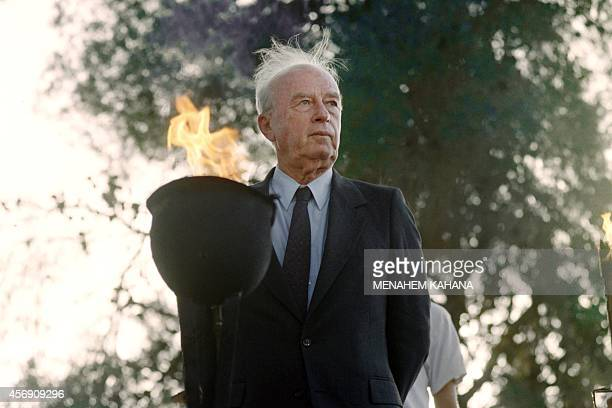 """Israeli Prime Minister Yitzhak Rabin lights a flame on May 19, 1993 on Jerusalem day, at a memorial for soldiers who fell on """"Ammunition Hill"""", 26..."""