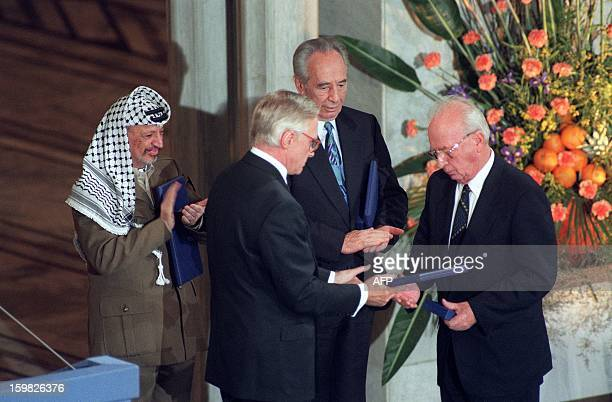 Israeli Prime Minister Yitzhak Rabin receives the 1994 Nobel peace prize from Francis Sejersted, chairman of the Nobel committee, on December 10, at...