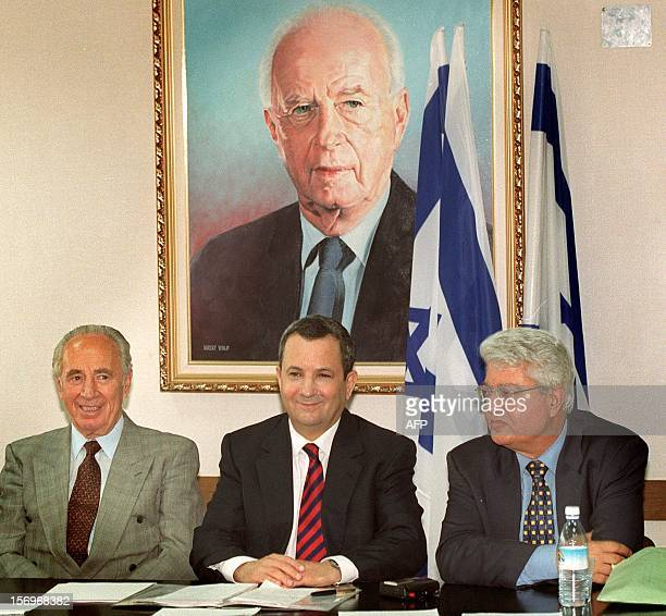 Israeli Prime Ministerelect Ehud Barak and his deputies Shimon Peres and David Levy sit under a portrait of assassinated PM Yitzhak Rabin 24 June...