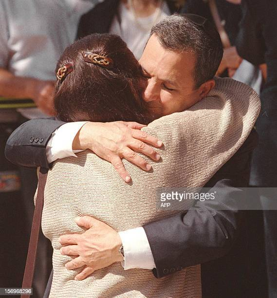 Israeli Prime Minister-elect Ehud Barak hugs Leah Rabin, the widow of late Israeli Premier Yitzhak Rabin, 18 May 1999 at Mount Herzel in Jerusalem, a...