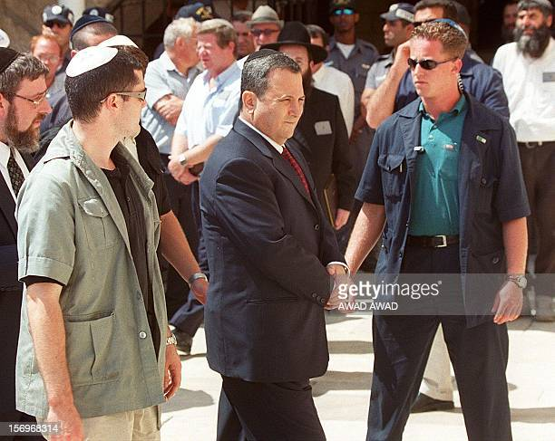 Israeli Prime Minister-elect leader Ehud Barak arrives at Jerusalem's Old City Western Wall 18 May 1999, a day after his landslide victory over...