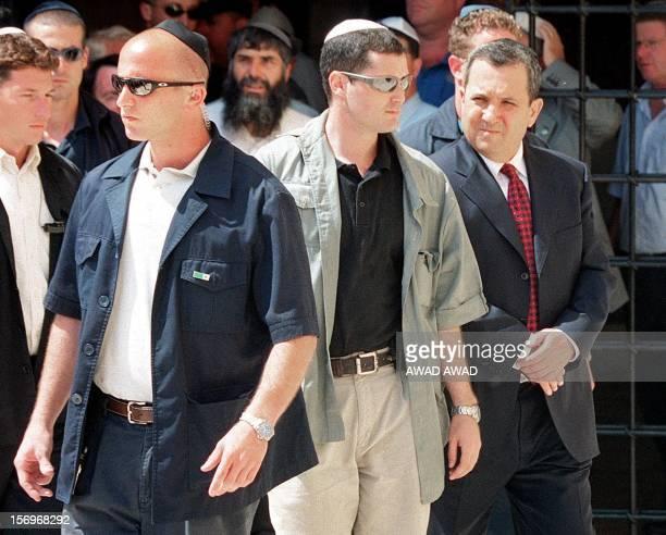 Israeli Prime Minister-elect leader Ehud Barak arrives under heavy escort at Jerusalem's Old City Western Wall 18 May 1999, a day after his landslide...