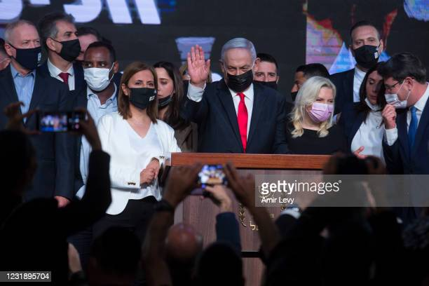 Israeli Prime Minster Benjamin Netanyahu, his wife Sara Netanyahu and Likud party members greet supporters in the Likud party after vote event on...