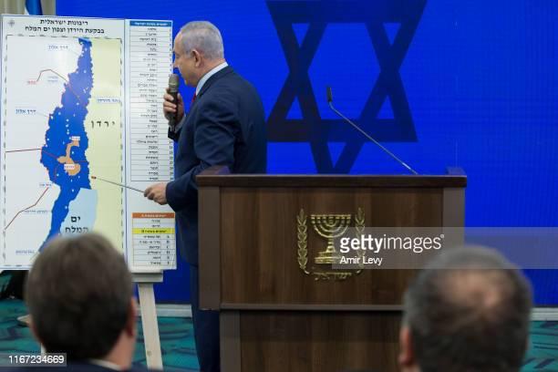 Israeli Prime Minster Benjamin Netanyahu points to a Jordan Valley map during his announcement on September 10 2019 in Ramat Gan Israel Netanyahu...