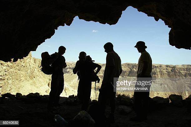 Israeli researchers from the Israeli Cave Research Center search a caves area in Nahal Arugot near the Dead Sea on the West Bank 05 May 2005 after...