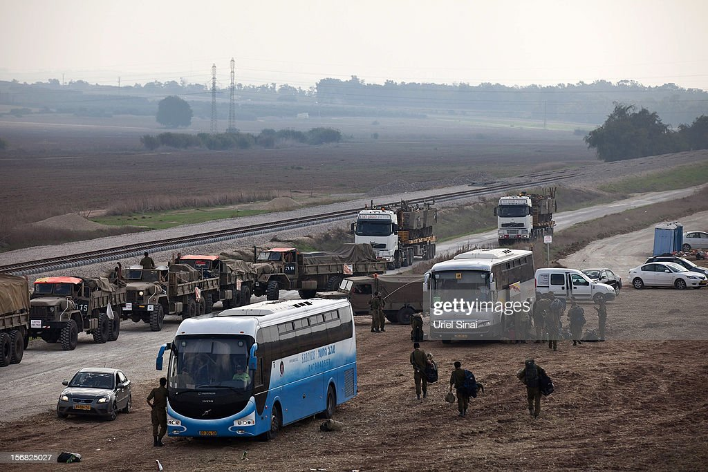 Israeli reserve soldiers and army vehicles depart the Gaza border area on November 22, 2012 near Israel's border with the Gaza Strip. The ceasefire between Israel and Hamas appears to be holding despite rockets being fired from Gaza. During the night the IDF reportedly arrested a number of 'terror operatives' in the West Bank in continued efforts to restore peace in the region.