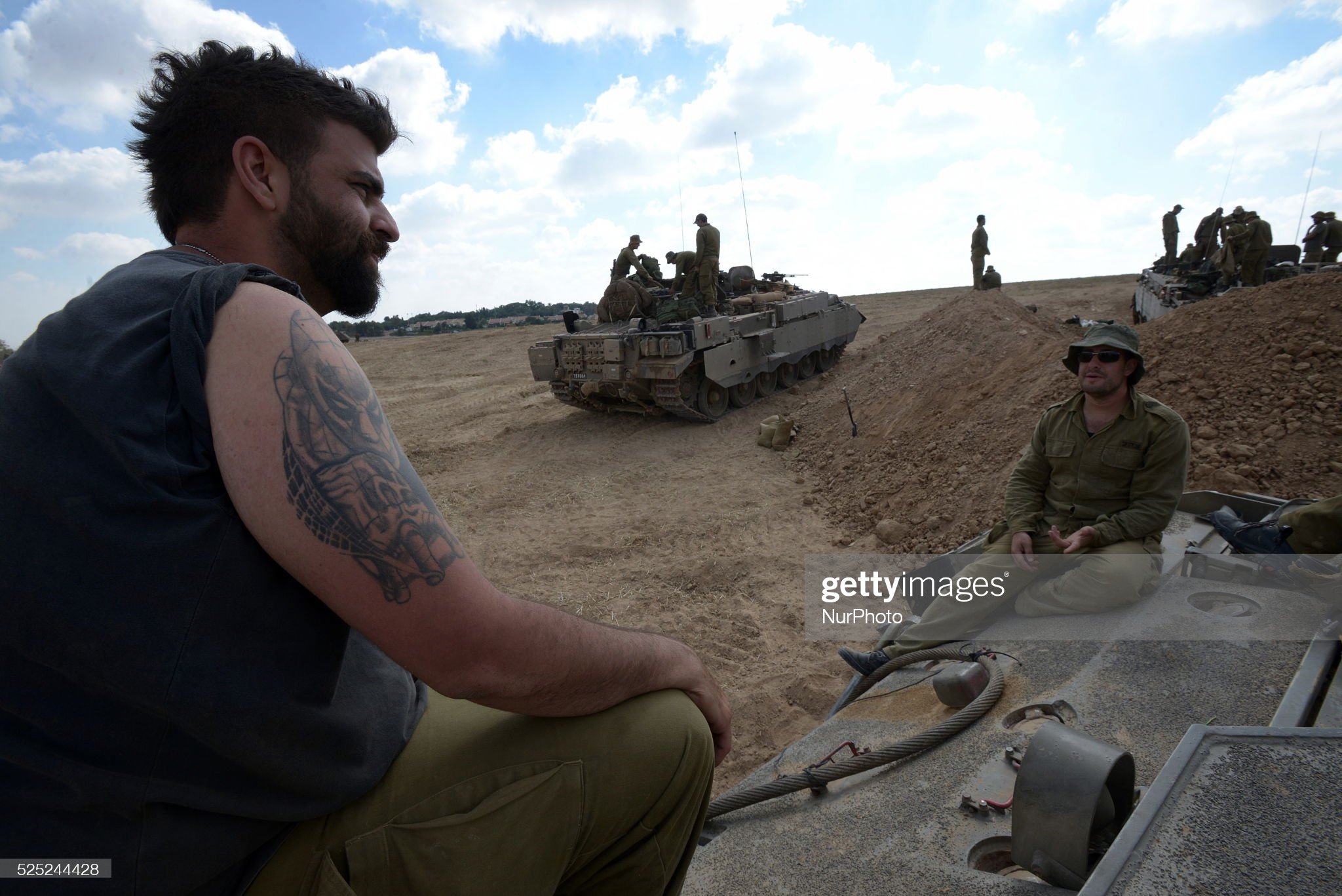 https://media.gettyimages.com/photos/israeli-reserve-soldiers-in-an-army-deployment-area-near-israels-picture-id525244428?s=2048x2048
