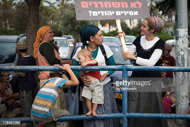 Israeli right wing activists and family members of Jewish prisoners who killed Palestinians protest outside Ayalon prison in demand of the release of...