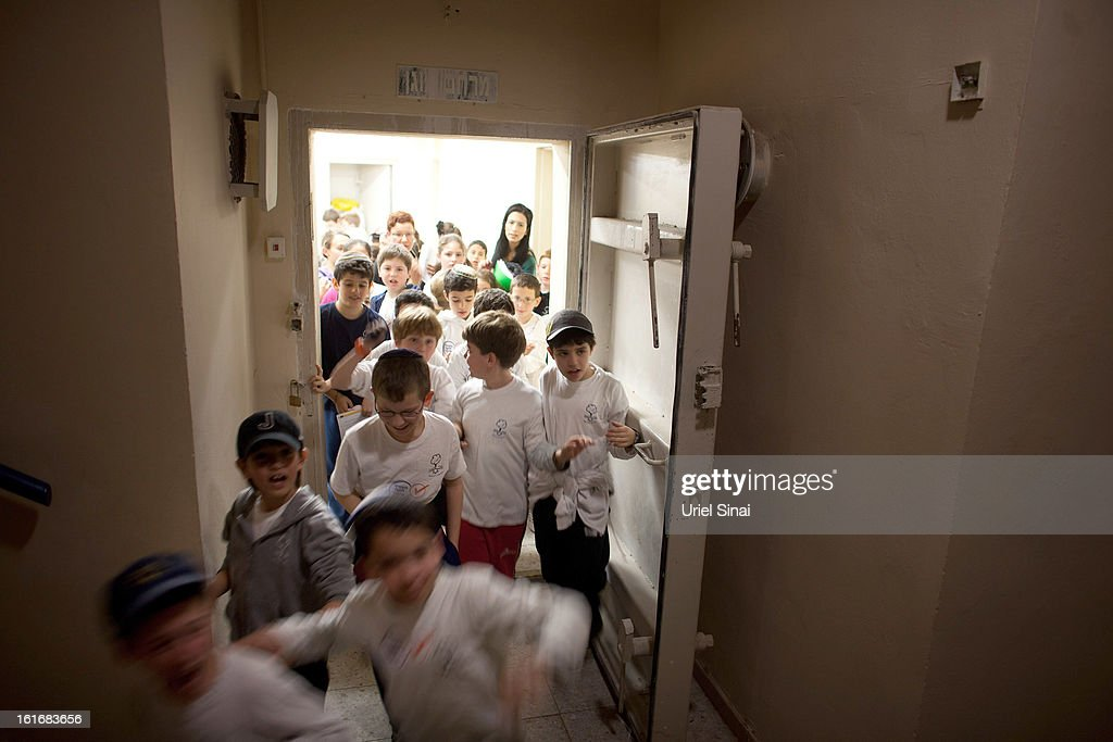 RA'ANANA, ISRAEL - FEBRUARY 14: Israeli schoolchildren exit a bomb shelter during a Home Front command drill simulating a rocket hitting a school on February 14, 2013 in Ra'anana, Israel. Working with the schools and emergency services, local authorities want to increase readiness for possible future attacks.