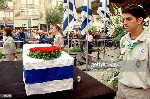 Israeli scouts stand by as honor guards for the flag-draped coffin of Leah Rabin, wife of assassinated former Prime Minister Yitzhak Rabin, during a...