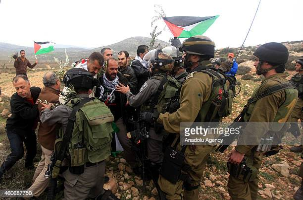 Israeli security detains demonstrators during a protest against separation barrier after Friday Prayer in Turmusayye town where Palestinian official...