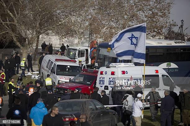 Israeli security forces and emergency personnel gather at the site of a vehicleramming attack on January 8 2017 in Jerusalem Israel Four israeli...