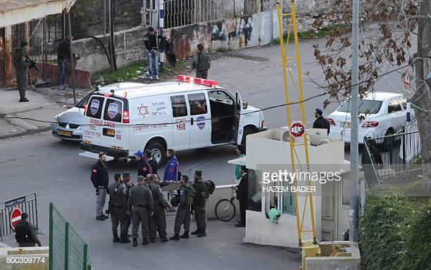 Israeli security forces and medical staff gather at the site where a Palestinian stabbed an Israeli before being shot dead by security forces near...