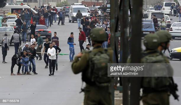 Israeli security forces are seen facing Palestinian protestors near the Huwara checkpoint south of Nablus in the Israelioccupied West Bank on...