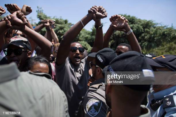 Israeli Security forces argue with Israelis of Ethiopian origin as they protest outside the Knesset on July 15 2019 in Jerusalem Israel The protests...