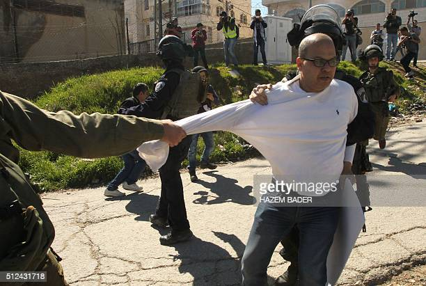 Israeli security forces arrest a Palestinian demonstrater during a protest near the Jewish settlement of Kiryat Arba demanding the reopening of...