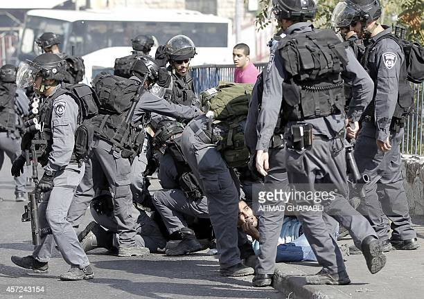 Israeli security forces arrest a Palestinian during clashes between Palestinian protesters and Israeli police after authorities limited access for...