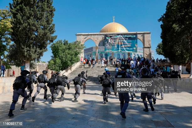 Israeli security forces arrive at the al-Aqsa Mosque compound in the Old City of Jerusalem on August 11 as clashes broke out during the overlapping...