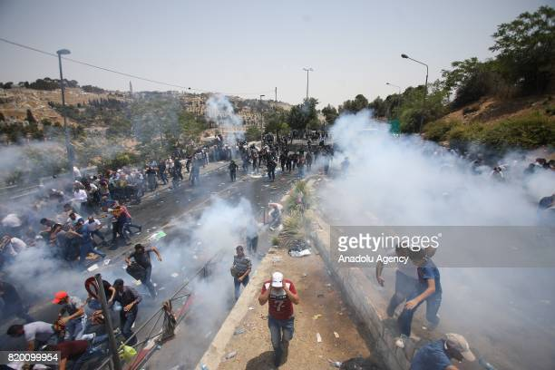 Israeli security forces attack Palestinians with tear gas after Muslim worshippers perform Friday prayer outside AlAqsa Mosque Compund in Valley of...