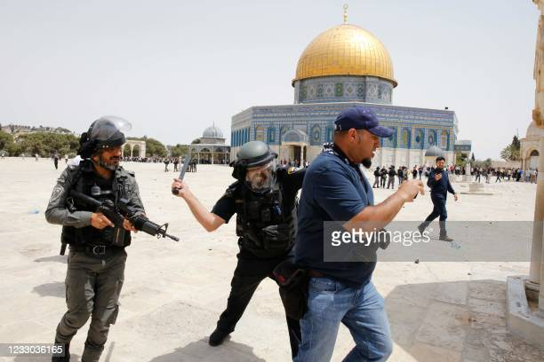 Israeli security forces beat AFP photographer Ahmed Gharabli during his coverage of clashes between Muslim worshippers and Israeli security forces in...