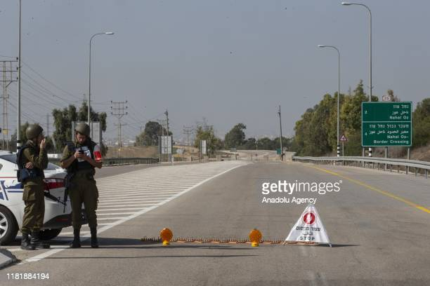 Israeli security forces block a road after tension started to rise following the airstrike of Israeli army, killing Bahaa Abu Al-Atta, a commander in...