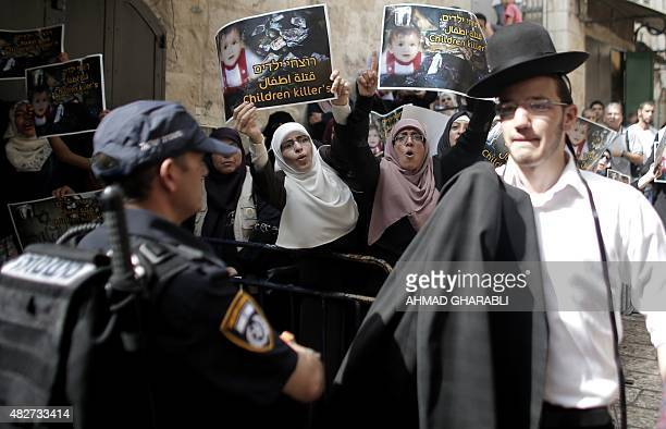 Israeli security forces block Palestinian protesters from using a road leading to the annexed east Jerusalem AlAqsa mosque compound on August 2 2015...