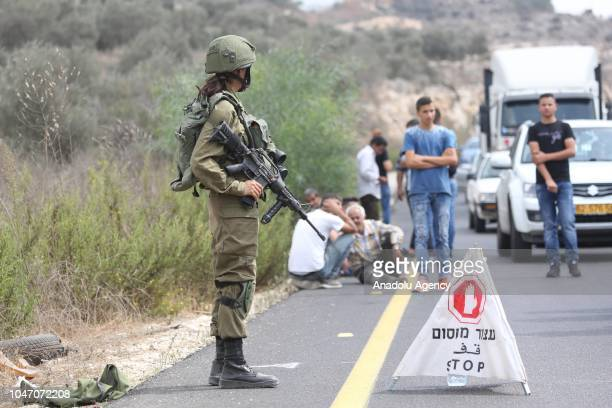 Israeli security forces block the road and take security measures after an armed assault at Barkan industrial zone near Ariel Israeli settlement...