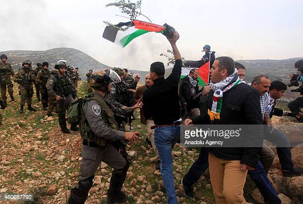 Israeli security forces clash with demonstrators during a protest against separation barrier after Friday Prayer in Turmusayye town where Palestinian...