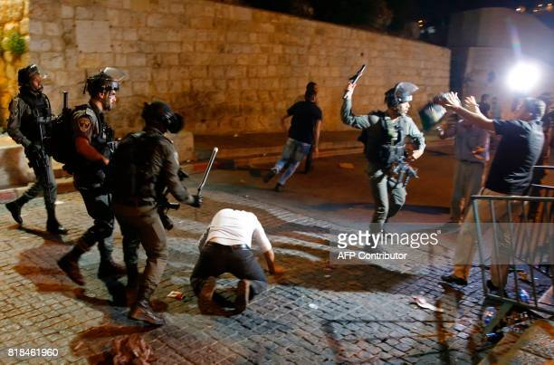 TOPSHOT Israeli security forces clash with Palestinian demonstrators after Palestinian Muslim worshippers prayed outside Lion's Gate after they...
