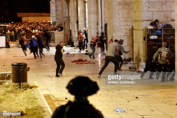 Israeli security forces clash with Palestinian protesters at the al-Aqsa mosque compound in Jerusalem, on May 7, 2021.