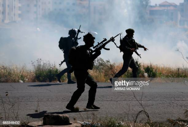 Israeli security forces clash with Palestinian protesters following a demonstration marking the 69th anniversary of Nakba which rememberss those...