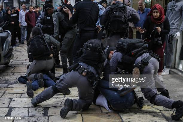 Israeli security forces clash with people as they gather for a demonstration to show solidarity with Palestinian prisoners, who continue hunger...