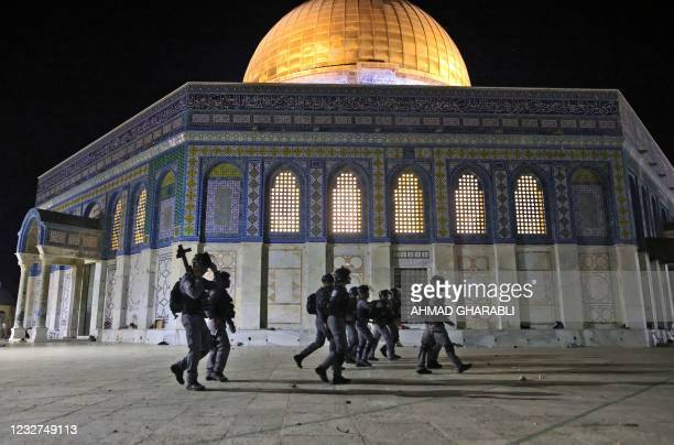 Israeli security forces deploy next to the Dome of the Rock mosque amid clashes with Palestinian protesters at the al-Aqsa mosque compound in...