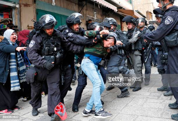 TOPSHOT Israeli security forces detain a man in Jerusalem's Old City on December 15 2017 Thousands of Palestinian protested again in Jerusalem...