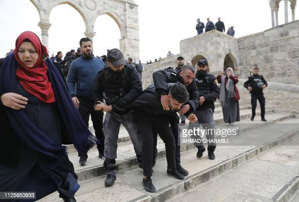 Israeli security forces detain a Palestinian demonstrator during clashes after protesters tried to break the lock on a gate at the AlAqsa mosques...