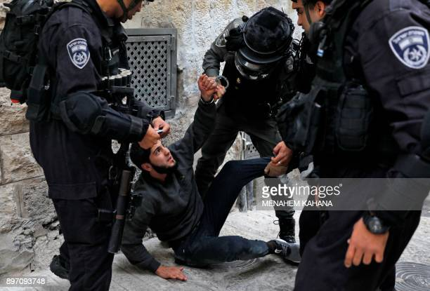 Israeli security forces detain a Palestinian man in the Old City of Jerusalem on December 22 as protests continue in the region amid anger over the...