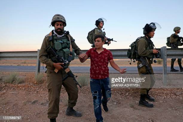 Israeli security forces detain a Palestinian protester amid clashes following a rally against Israel's West Bank annexation plans, in the Jordan...