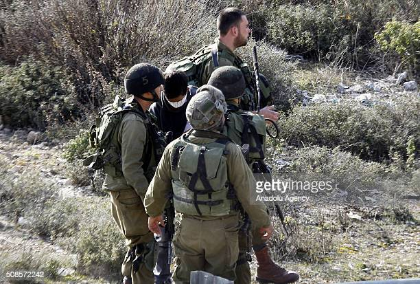 Israeli security forces detain a Palestinian who protest Israeli separation wall at Halhul town of Hebron West Bank on February 5 2016