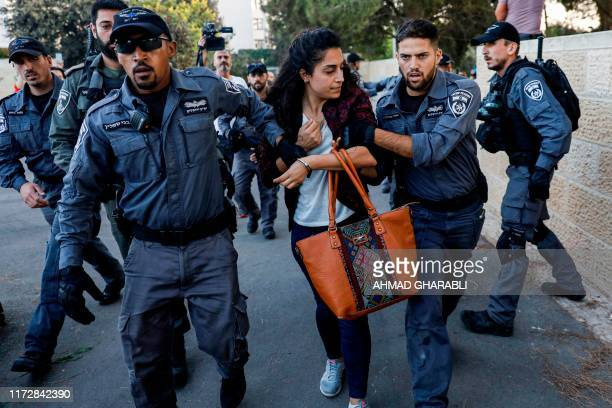 Israeli security forces detain a Palestinian woman during a demonstration near the Hadassah Medical Center Mount Scopus in Jerusalem on October 1 in...
