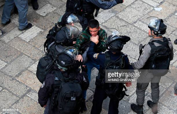 Israeli security forces detain a Palestinian youth during a patrol in Jerusalem's Old City on December 15 as demonstrations continue to flare in the...