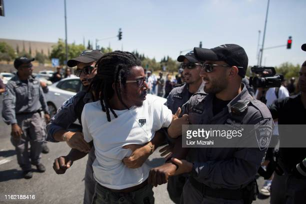 Israeli Security forces detain an Israelis man of Ethiopian origin as they protest outside the Knesset on July 15 2019 in Jerusalem Israel The...